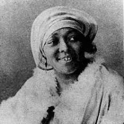 This actually is not a true photo of Geeshie Wiley, rather a woman during the pre-war era. There are no known photos of Geeshie Wiley.