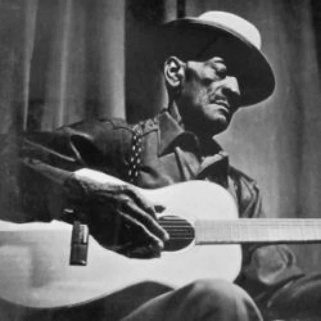 A photo of Mance Lipscomb in performance in the 1960s most likely