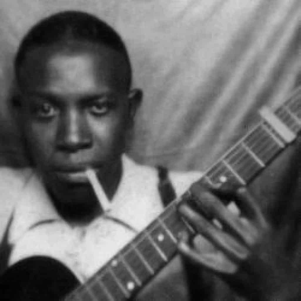 A classic photo of Robert Johnson, discovered in the 1990s I believe, of him with a cigarette in his mouth, posing casually