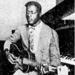 Blind Willie Johnson's only known photo, playing the guitar upright